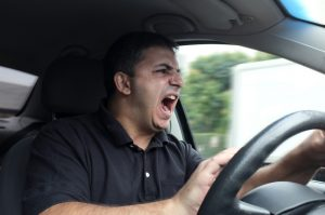 Tips for Protecting Yourself in a Road Rage Situation Guy Driving Honking Yelling
