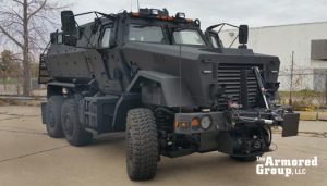 The Armored Group LLC Truck Front Side Corner View Six Wheels Black