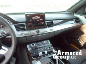 TAG Interior of Audi A8L W12 sedan with back-up camera screen