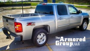 TAG Armored Vehicles Chevy Silver Truck Rear Side Corner Tail Light View