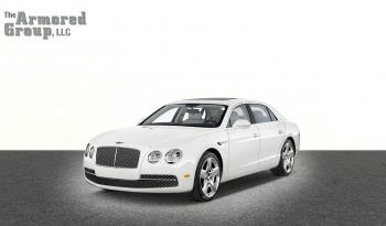 Picture of white armored Bentley Flying Spur sedan with bulletproof glass
