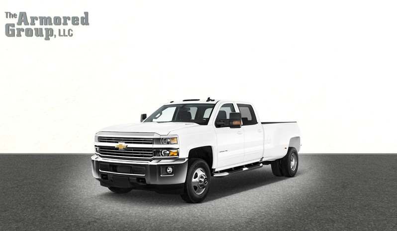 White armored Chevrolet Silverado 3500 truck picture