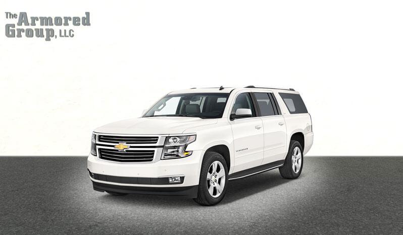 White armored Chevrolet Suburban 3500 SUV picture