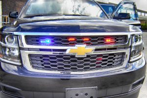 TAG Emergency lighting system on a black armored Chevrolet Suburban 1500
