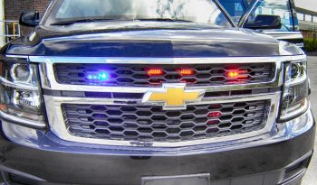 Emergency lighting system on a black armored Chevrolet Suburban 1500