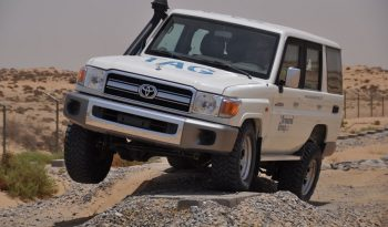 White armored Toyota Land Cruiser (TLC) 76 Series cash-in-transit SUV with upgraded suspension in the desert