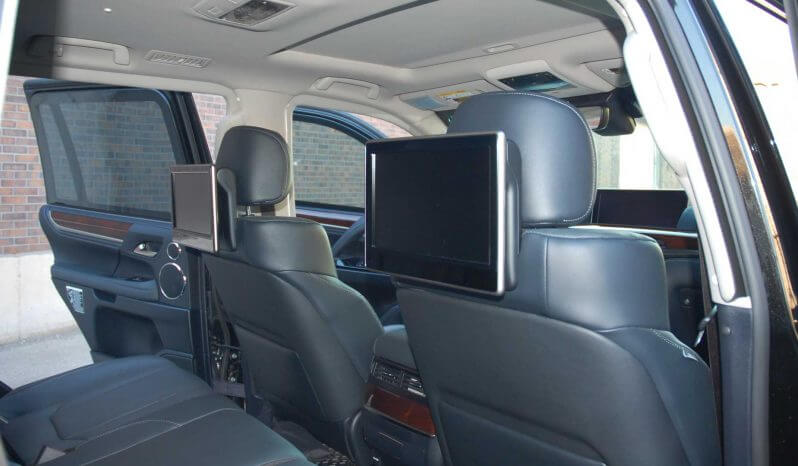 Interior of armored Lexus LX570 SUV with TV screens