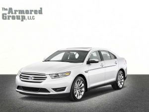 TAG Picture of white armored Ford Taurus sedan with blast protection