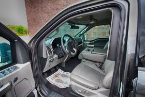 TAG Interior of bulletproof Ford F-150 truck cab with hydraulic steering