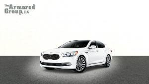 TAG Picture of white armored KIA K900 sedan with blast protection