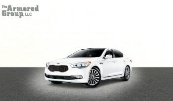 Picture of white armored KIA K900 sedan with blast protection