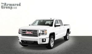 TAG White armored GMC Sierra Line 1500 cash-in-transit truck picture