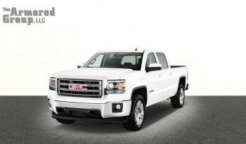 White armored GMC Sierra Line 1500 cash-in-transit truck picture