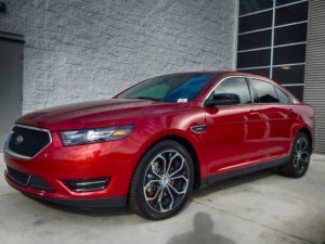TAG Picture of red armored Ford Taurus sedan with run-flat tire systems