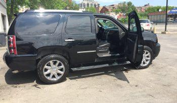Interior of bulletproof GMC Yukon Denali SUV with reinforced door hinges