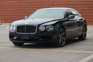 TAG Armored Bentley Flying Spur Series Picture of black armored Bentley Flying Spur sedan with blast protection