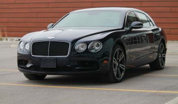 Picture of black armored Bentley Flying Spur sedan with blast protection