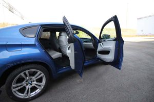 TAG Blue armored BMW X5 SUV interior with bulletproof glass