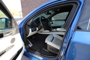 TAG Armored BMW X5 Blue armored BMW X5 SUV interior steering wheel picture