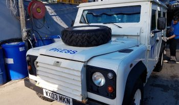 White pre-owned 2003 armored Land Rover Defender SUV picture
