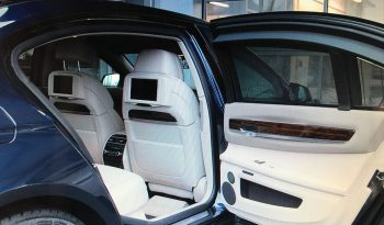 Backseat screens inside pre-owned 2012 armored BMW 7 sedan