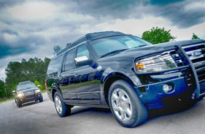 TAG Armored Ford Expedition Two SUV Driving Front