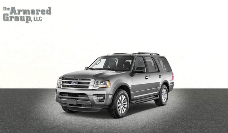 Silver armored Ford Expedition SUV passenger vehicle picture