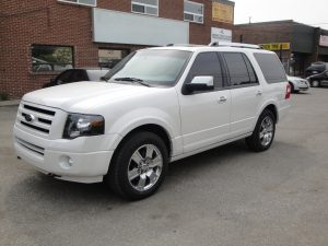 TAG White armored Ford Expedition SUV passenger vehicle picture