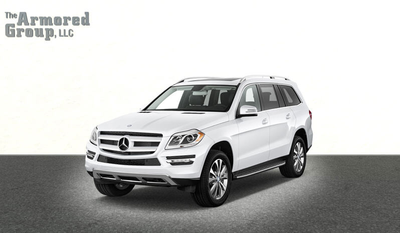 White armored Mercedes GL Class GLS SUV passenger vehicle picture