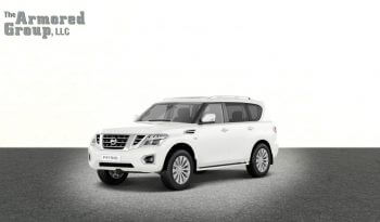 White armored Nissan Armada SUV picture