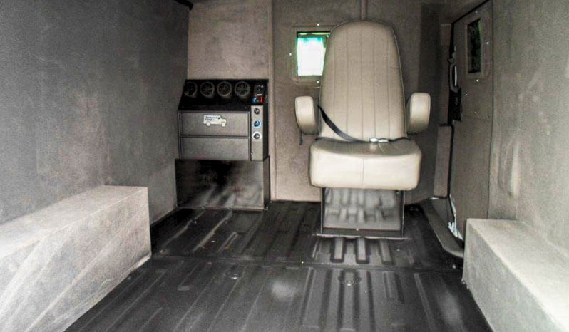 Interior of bulletproof Nissan NV cash-in-transit cargo van