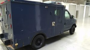 TAG Blue pre-owned armored 2002 Ford E250 cash-in-transit box truck picture