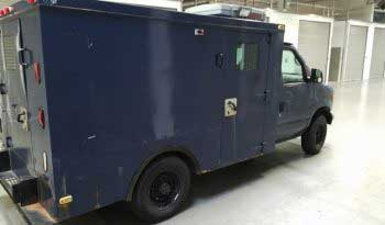 Blue pre-owned armored 2002 Ford E250 cash-in-transit box truck picture