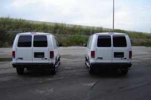 TAG Ford E250 CIT Two Parked Next Each Other Rear View