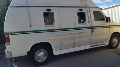 Used white pre-owned armored 1992 Ford E350 cash-in-transit van picture