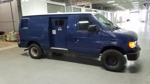 TAG Blue pre-owned 1999 Ford E250 cash-in-transit armored van picture