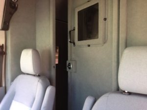 TAG Ford Transit 250 CIT Front Seats Bullet Proof Access Door Open