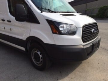 TAG Ford Transit 250 CIT Passenger Front Corner View
