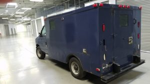 TAG Rear view of blue pre-owned armored 2002 Ford E250 cash-in-transit vehicle