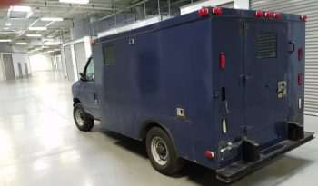 Rear view of blue pre-owned armored 2002 Ford E250 cash-in-transit vehicle