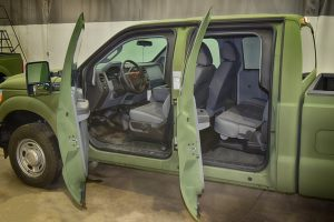 TAG Interior of green bulletproof Ford F-350 truck