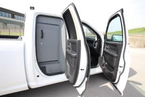 TAG Armored Dodge Ram 1500 White armored Dodge Ram 1500 interior with bulletproof glass