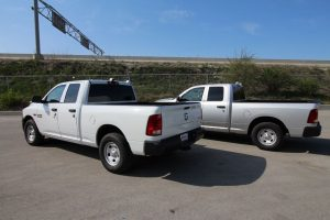 TAG Armored Dodge Ram 1500 Two Trucks Side Rear Corner Views