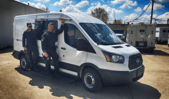 Personnel on non-armored Ford law enforcement raid and warrant van