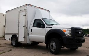TAG 2013 Armored Ford F550 CIT Exterior Front Side Corner Passenger View White