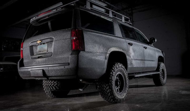 Rear view of black armored Chevrolet tactical SWAT suburban picture