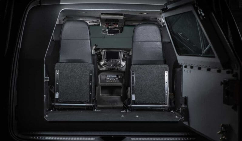 Interior of bulletproof Chevrolet Tactical Suburban 3500LT with fold-up seats.