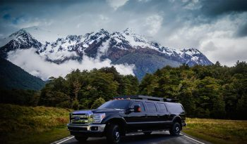 TAG Tactical Utility Vehicles Ford Mobile Commander Front Side Corner View Background Mountain Forest View