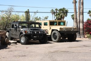 TAG Armored Hummer Front Corner Side View Multiple Hummers Outdoors