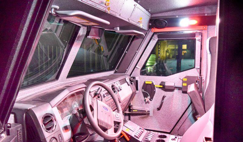 BATT-X armored vehicle with nighttime lighting